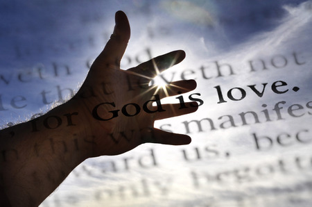 reading bible: Detail closeup God is love scripture in bible verse Stock Photo