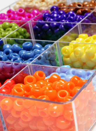 the trappings: Closeup of beads in bins separated for making crafts jewelry