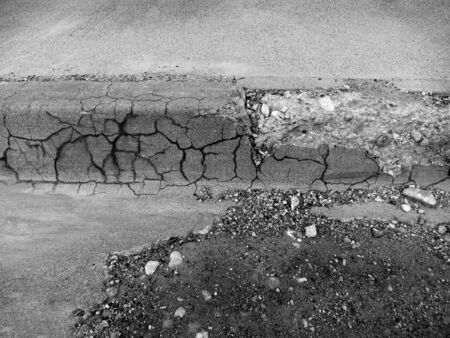 uneven: Part of curb and gutter cracked and broken Stock Photo