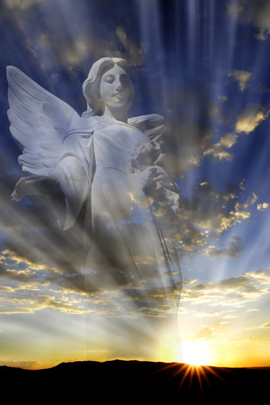 Angel with wings in front of heavenly light Stock Photo