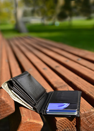 lost money: Wallet lost and left on a park bench with cash credit cards