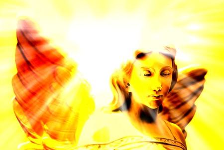Angel with wings in front of heavenly light Foto de archivo