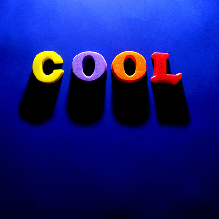 vibrance: The word cool spelled out with blue background Stock Photo