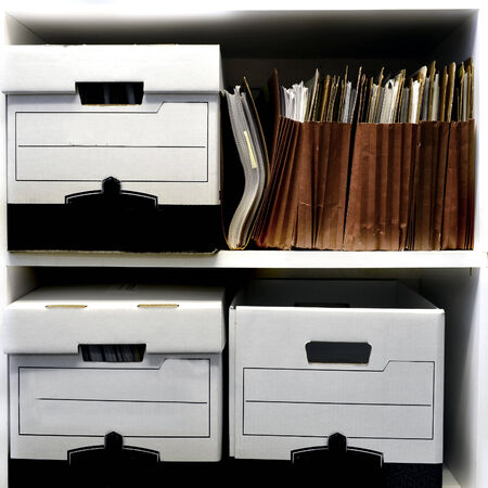 Office shelves full of files and boxes Foto de archivo
