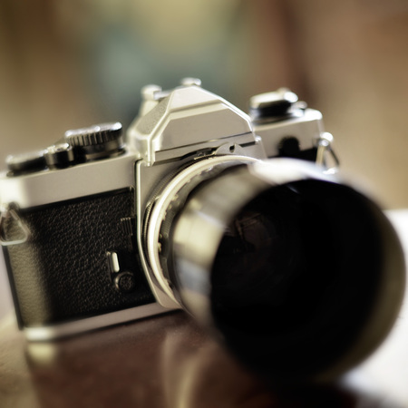 Old camera and lens for photography art Stock Photo - 28040318