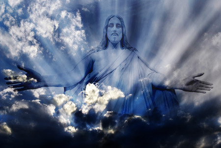 hand: Jesus standing in white and gray storm clouds in blue sky with rays of light