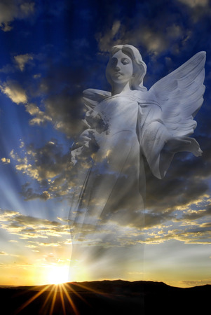 Hope and love through an Angel and rays of light photo