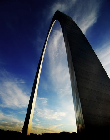 Base of St. Louis Arch with Silhouette and sky photo