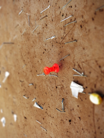Bulletin cork board with staples and red tack