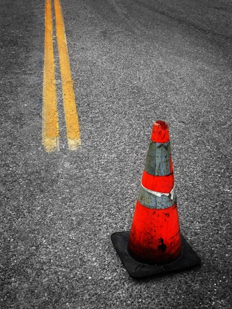 Detail of Construction Cone yellow street lines suggesting repair photo