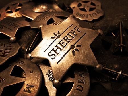 sheriffs: Sheriffs tin badge in pile of star law enforcement badges