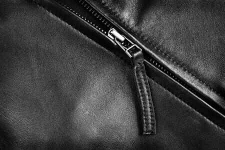 hem: Deep textured leather jacket with silver zipper Stock Photo