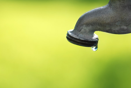 water drip: Detail of dripping faucet with water drop Stock Photo