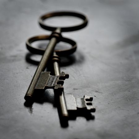 lock and key: Old keys lying on top of worn wood