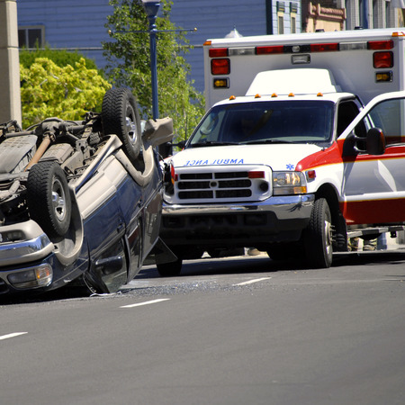 flipped: Car Wreck with Rolled Car Police and Ambulance