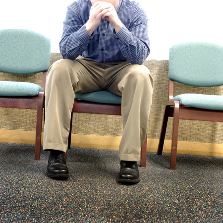 room: Man grieving with sorrow and sadness in waiting room