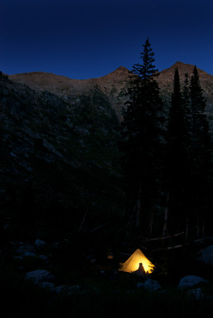 roughing: Detail of camping in glowing tent at night in mountains