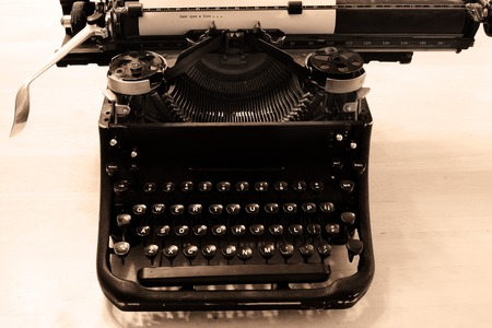 Closeup of old typewriter letters and keys for typing on documents business