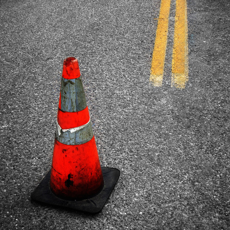 Detail of Construction Cone yellow street lines suggesting repair Stock Photo