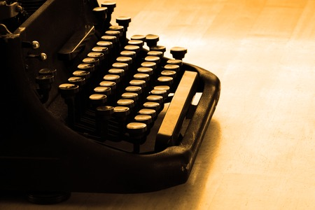 Closeup of old typewriter letters and keys for typing on documents business photo