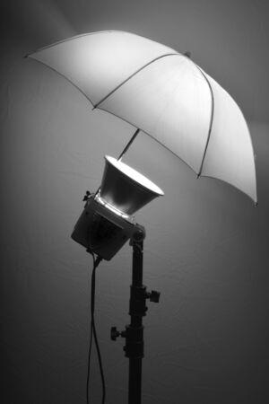 monolight: Detail of studio flash strobe light and umbrella on stand strobist professional photographer