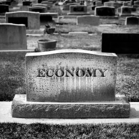 downturn: Gravestone for Economy and Investments Stock Photo