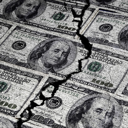 us paper currency: Several American Dollars ripped or torn in half symbolizing the destruction of the economy
