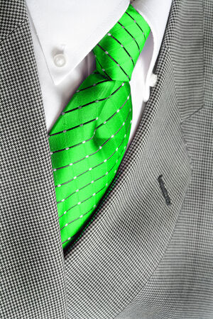 white dress: White dress shirt with green tie and suit jacket detailed closeup