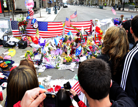 bombings: Memorial and People on Boyston Street in Boston after bombings with written statements Stock Photo
