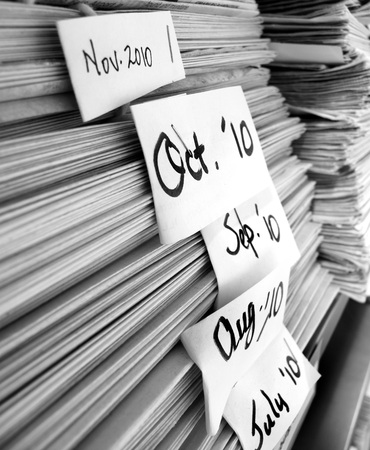 periodicals: Detail of stacks of newspapers periodicals news with dates Stock Photo