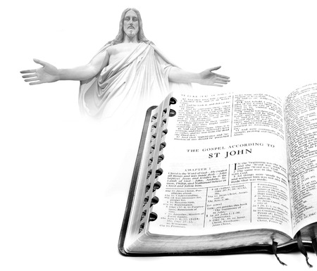 book of revelation: Open pages of bible isolated on white background Jesus