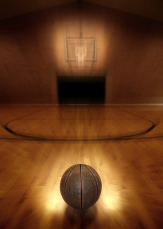court: Basketball on floor of empty basketball court Stock Photo