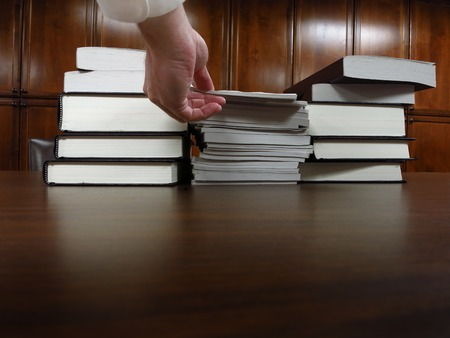 Stack of old books on a desk or table in a library Imagens - 35384008
