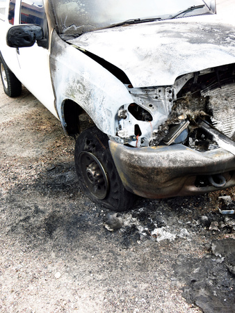 burned out: White pickup truck burned out and wrecked on roadside Stock Photo