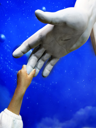 worship god: Little child holding hand of Jesus Statue showing faith spirit religion belief