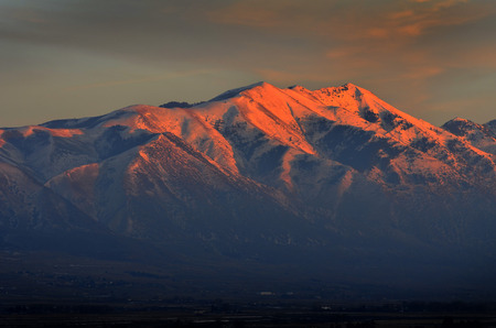 towering: Landscape of tall mountain with glowing sunlight from sunset or sunrise