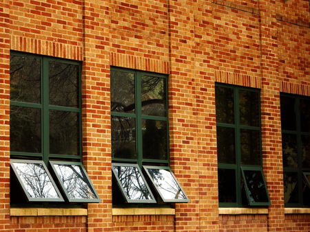 refelction: Office building details reflecting sky and clouds in windows