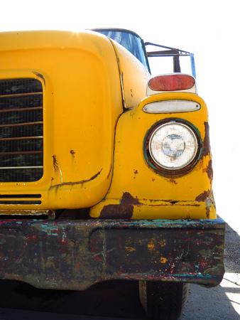 chipped: Old yellow school bus with chipped paint and rust