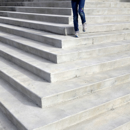 supreme court: Person walking down concrete steps of law building