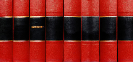 volumes: Close up of several volumes of books on bankruptcy Stock Photo