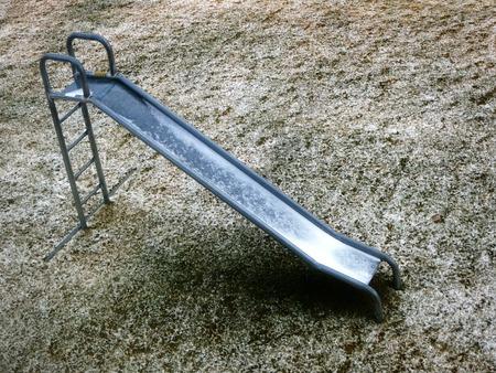 unused: Unused slide on playground in winter no kids