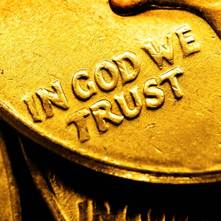 goldbars: Pile of old coins and bullion with dark background and words In God We Trust Stock Photo