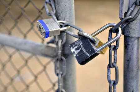 lock and chain: Several Locks and chain on fence gate for security