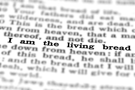 reverence: Detail closeup of New Testament Scripture quote I am the living breach Stock Photo