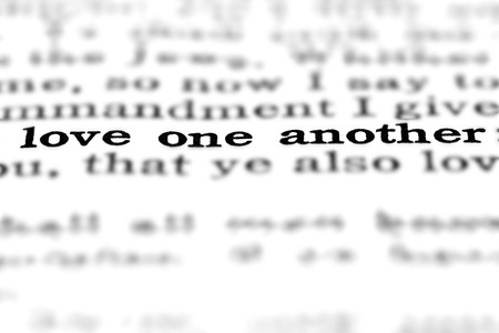 Detail closeup of New Testament Scripture quote Love One Another Stock Photo