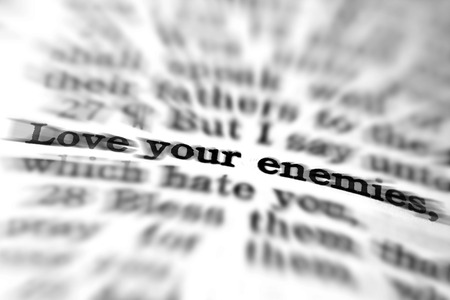 new testament: Detail closeup of New Testament Scripture quote Love Your Enemies