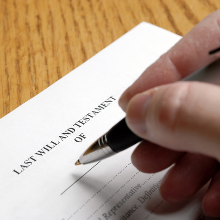 will power: Person signing a will with an elegant pen