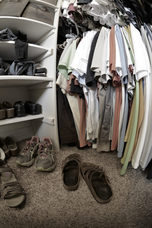 unorganized: Detail of messy closet in house with clothes and shoes