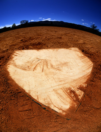 Baseball home plate with dirt and sky photo