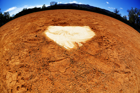 homeplate: Baseball home plate with dirt and sky curved like a world Stock Photo
